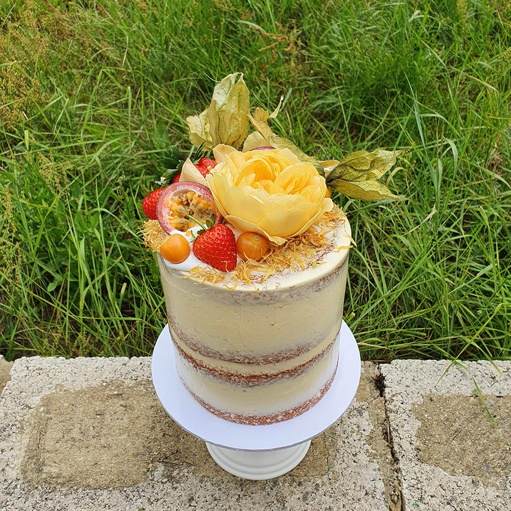Birthday cake with flowers and fruit