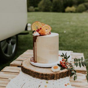 Boho Semi-Naked Wedding Cake with Dried Orange Slices, Dried Flowers, Caramel Drip