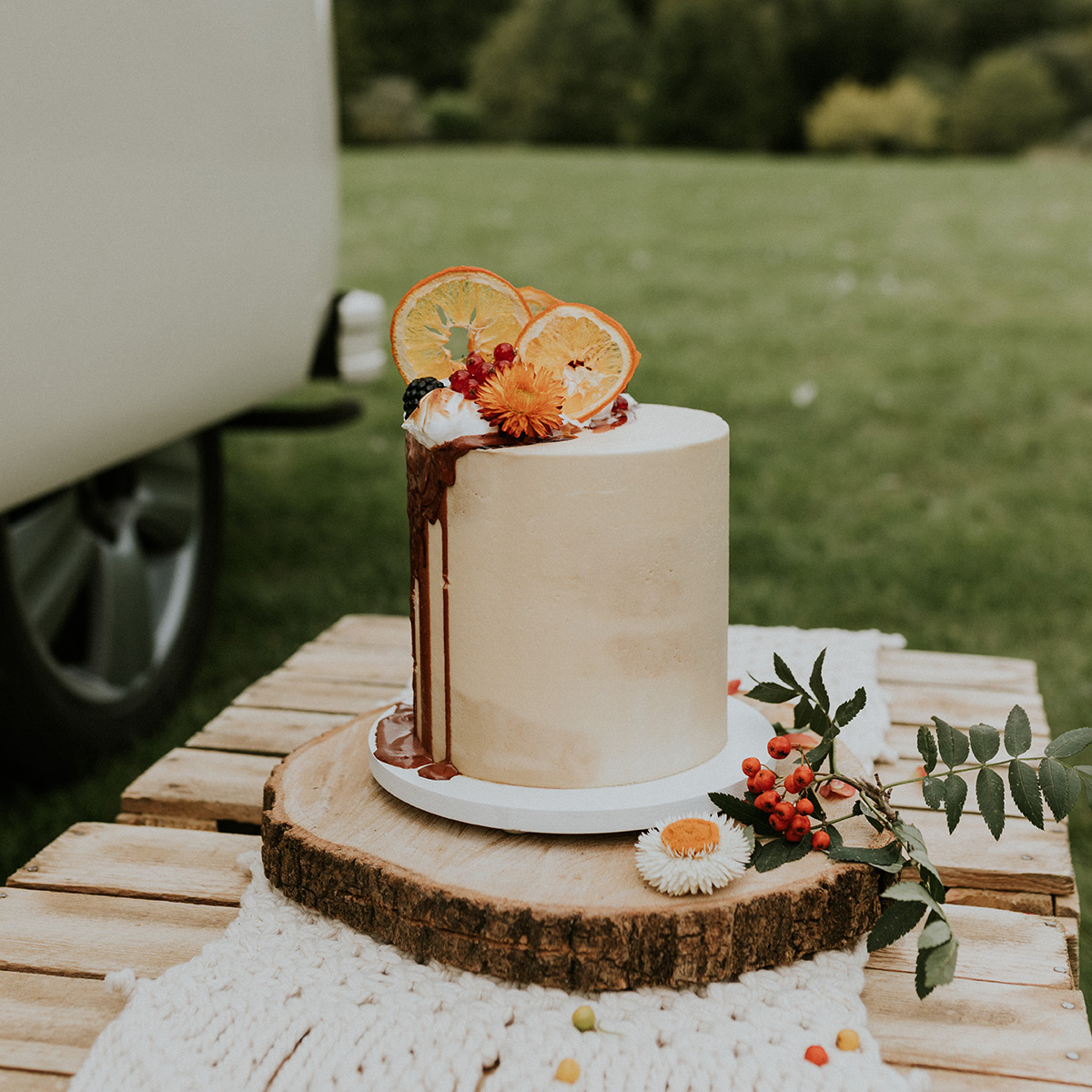 Boho Semi-Naked Wedding Cake with Dried Orange Slices, Dried Flowers, Caramel Drip