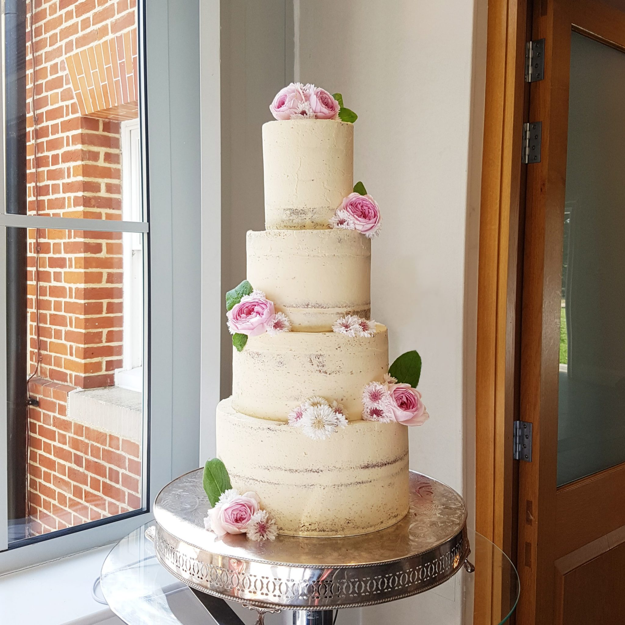 Semi-Naked Wedding Cake with White and Pink Flowers