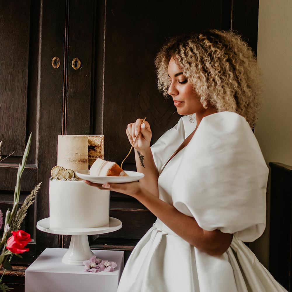2 Tier Wedding Cake with Bride Eating Slice