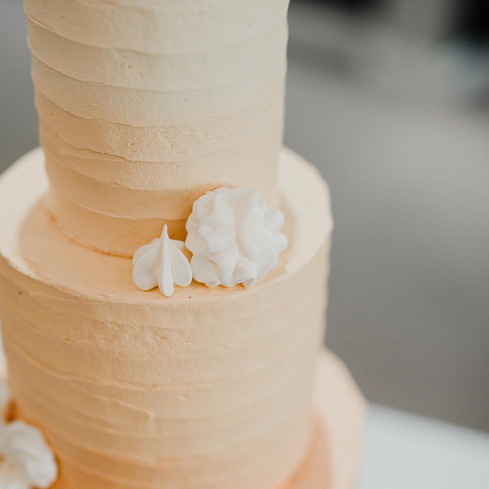 Peach Buttercream Wedding Cake with Meringue Flowers