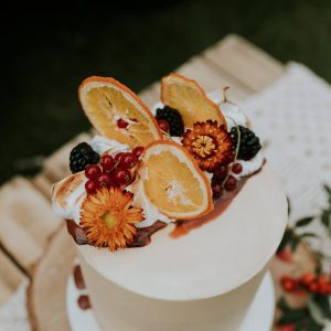 Semi-Naked Wedding Cake with Dried Flowers, Torched Meringue and Dried Fruit