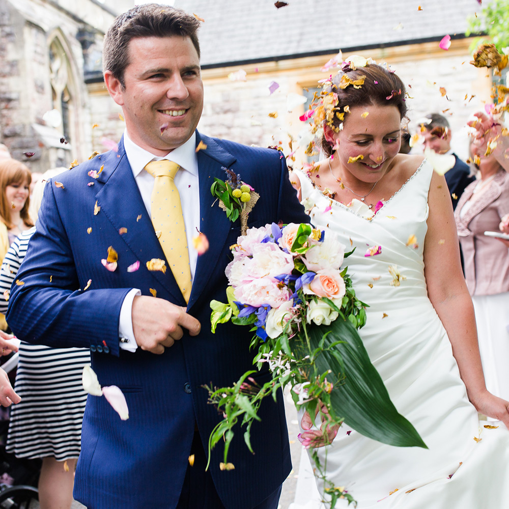 Married Couple with Bouquet and Confetti