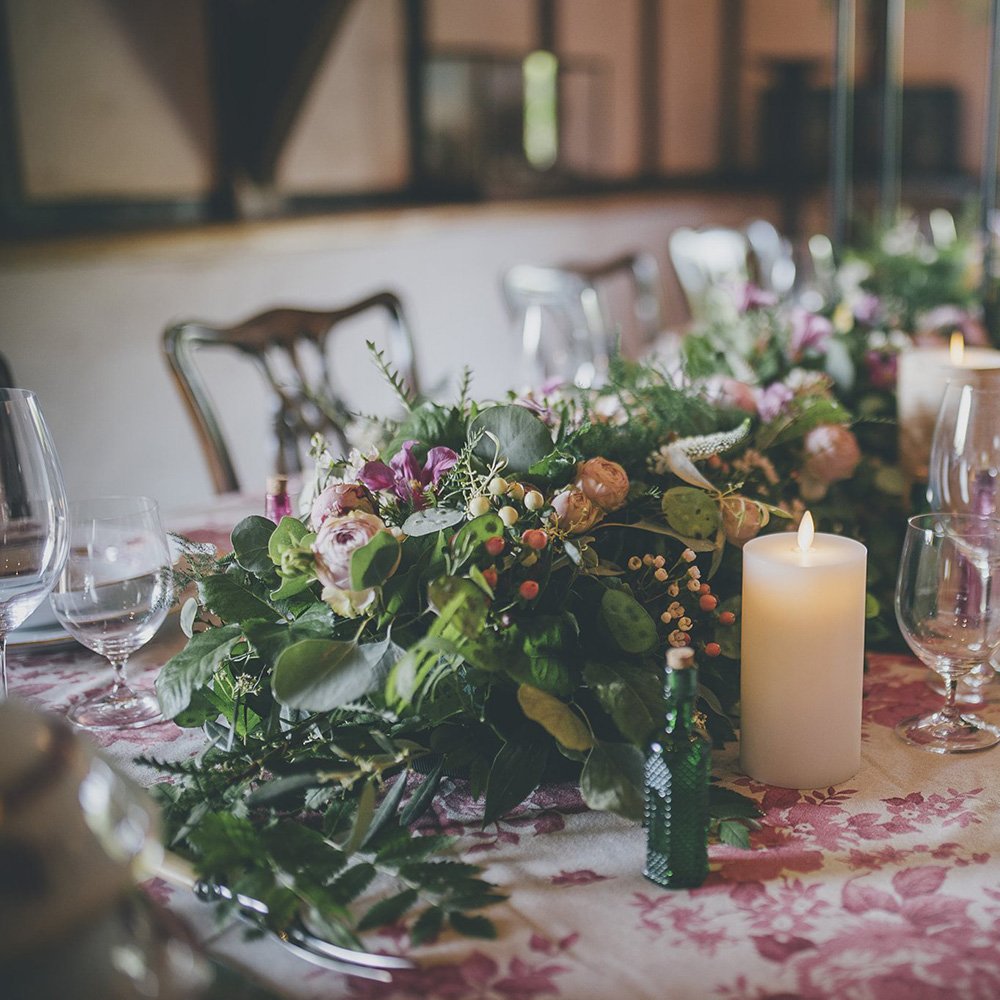 Candles and Floral Arrangement on Table
