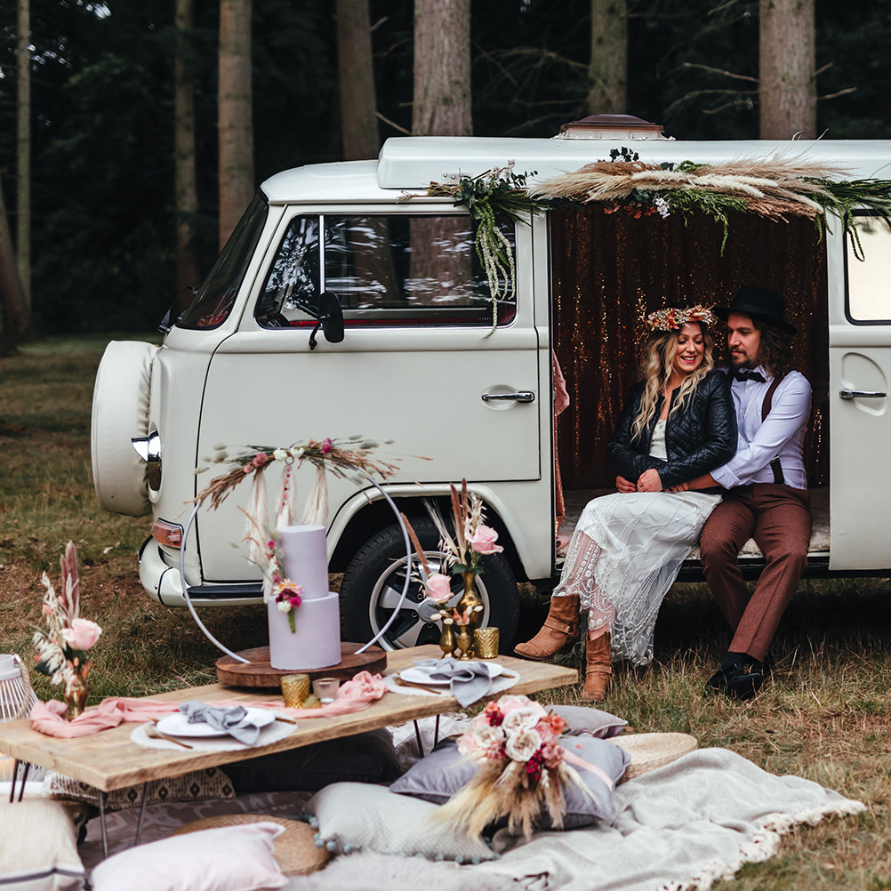 Couple Embracing in VW Camper in Woodland