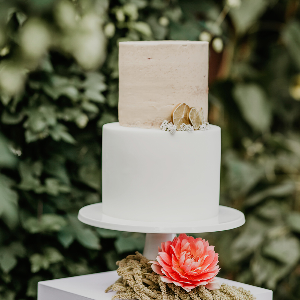 Fondant and Semi-Naked Wedding Cake with Dried Lime Slices on Plinth in Botanical Garden