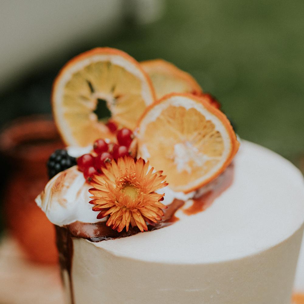 Autumn Wedding Cake Design - Torched Meringue, Dried Orange Flowers, Dried Orange Slices, Autumn Berries