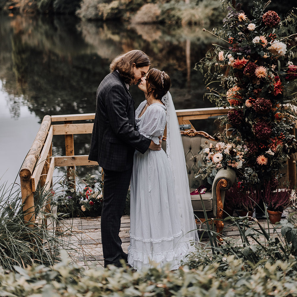 Romantic Wedding Venue - Couple Embracing in Front of Lake