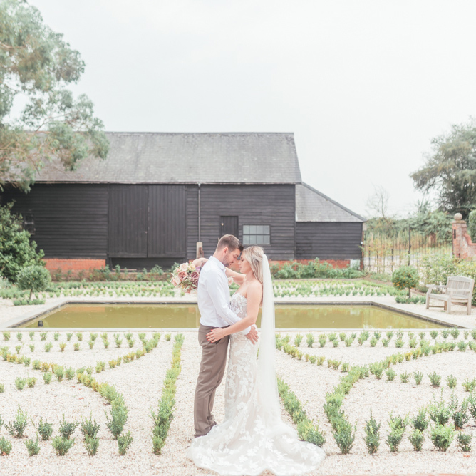 Couple Embracing in Landscaped Garden
